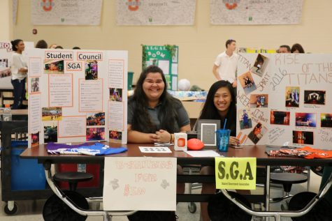 Junior SGA member Hannah Mulroney and Sophomore SGA member Tammy Nguyen showing off what SGA does at open house.