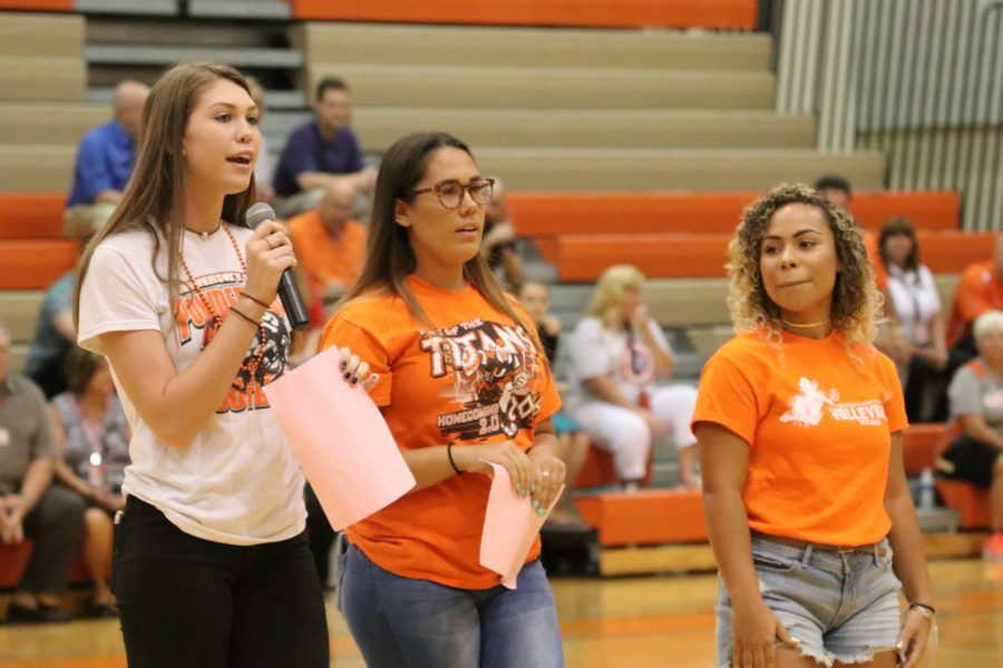 Senior Francis Nieves and juniors Courtney Redmond and Danae Bibaud volunteer during the Rising Titans pep rally for freshmen to get them in the school spirit.