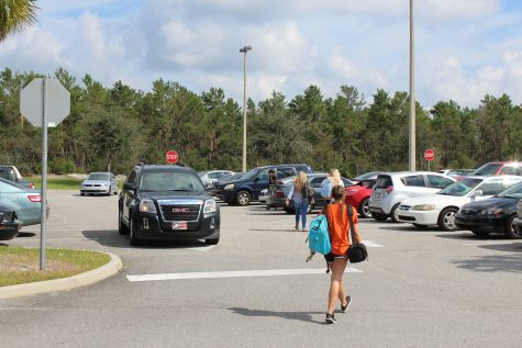 Students rush to their cars in attempt to leave as soon as possible during lunch-out.  Photo by Carson Francis