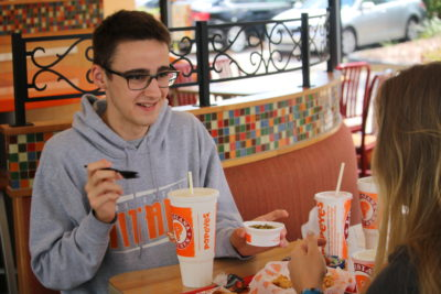 In an effort to stay healthy, juniors Connor Darby and Kendall Walsh opt for vegetables with their meal.