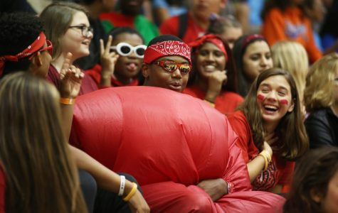 Surrounded by ladies, junior Jacobe Brown won the hearts of everyone while sporting the color red for class color day. Photo by Cierra Stark.