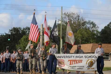 ROTC leads the parade, representing their the school for the pride of our country.  Photo by Carson Francis
