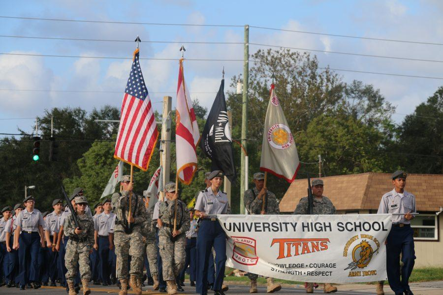 ROTC+leads+the+parade%2C+representing+their+the+school+for+the+pride+of+our+country.+%0APhoto+by+Carson+Francis+