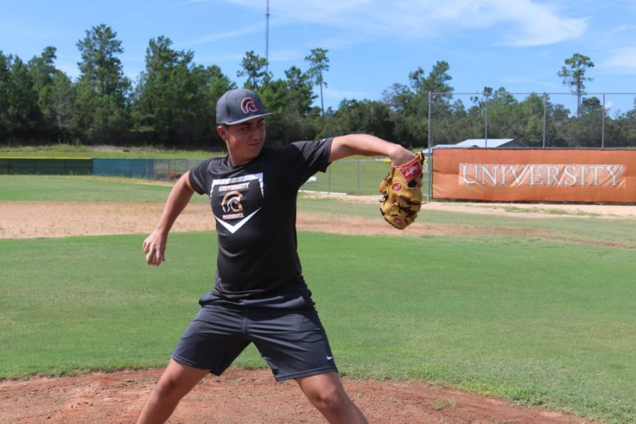 During a bullpen session, junior pitcher Austin Amaral works to perfect his mechanics and throw harder.