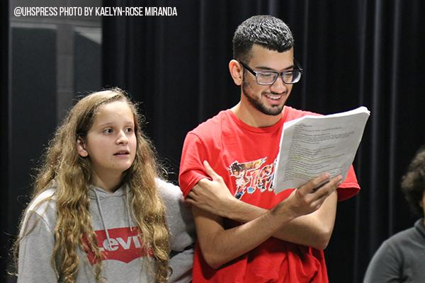 Behind the scenes, senior Edgardo Garcia and sophomore Jade Hoozky run through lines to prepare for theatre's one act.