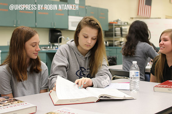 From recipes to food-related illnesses, culinary students engage with one another while completing textbook work.