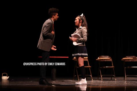 "Arguing in the final scene of the student directed one act, ""With Everlasting Love, Monika,"" MC, played by senior Lucas Laguer discovers that Monika, played by junior Tammy Nguyen, is controlling his entire life through the words she writes in her script. Nguyen held the script as her prop throughout the one act, however she expressed concern that the audience may think she is unprepared for her part. ""So I hold a script throughout the entire play and I feel really scared that everyone is just going to think that I don't know my lines which is not the reason I am holding the script,"" Nguyen said. ""[The audience] doesn't figure out the purpose of the scripts presence until the very end where I explain it."""