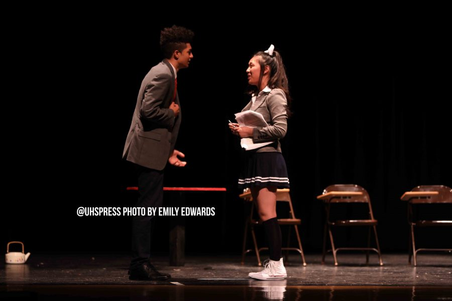 """Arguing in the final scene of the student directed one act, With Everlasting Love, Monika, MC, played by senior Lucas Laguer discovers that Monika, played by junior Tammy Nguyen, is controlling his entire life through the words she writes in her script. Nguyen held the script as her prop throughout the one act, however she expressed concern that the audience may think she is unprepared for her part. """"So I hold a script throughout the entire play and I feel really scared that everyone is just going to think that I don't know my lines which is not the reason I am holding the script,"""" Nguyen said. """"[The audience] doesn't figure out the purpose of the scripts presence until the very end where I explain it."""""""