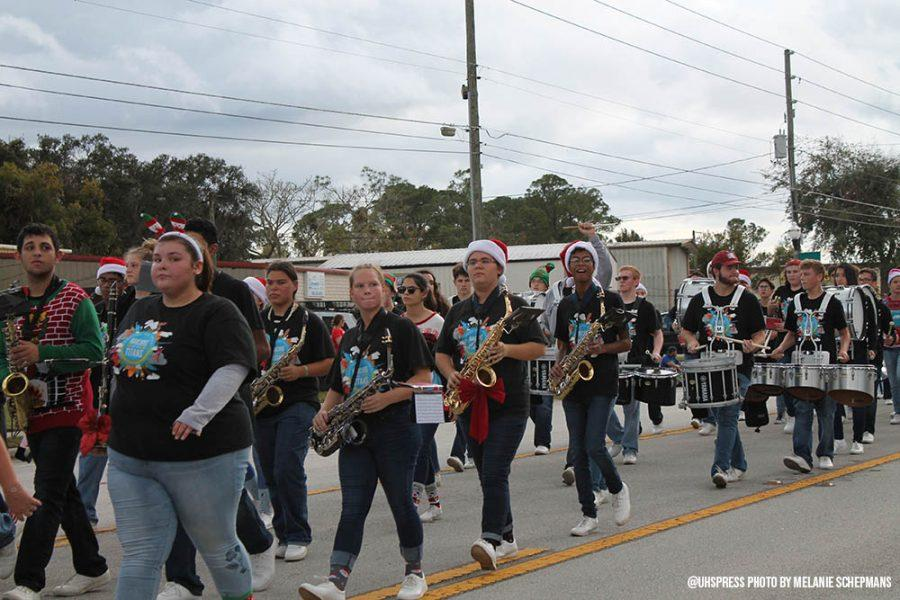 The+marching+band+moves+down+Charles+Richard+Beall+Boulevard+at+the+DeBary+Christmas+parade.