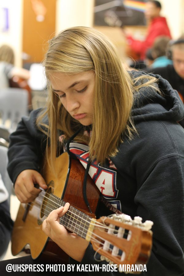 Practicing for her final test, sophomore Sydney Hemke is confident she will Ace her playing test. Inspired by her father's skills in guitar,  Hemke figured taking guitar at school would pay off.