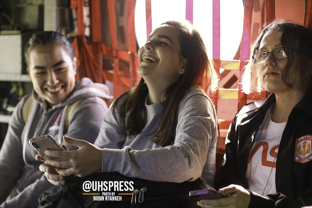 "(From left to right) Sophomores Azariah Rodriguez, Amber Puskarik, and senior Helena Santos take pictures inside the army jets and giant airplanes as they laugh at the silly selfies they took. ""It was very exciting seeing all the helicopters and all the branches of military there in one place,"" Amber said. ""It was cool listening to the different opportunities that the military has to offer too. I even found the air force very interesting because I would really like to become a pilot one day or something similar to that field. It's just so thrilling to see what's new each year and in general it's really fun."""