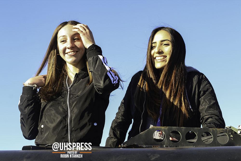 "(From left to right) Amused with the sight of their friends taking other candid photos of them nearby, sophomores Kenya Ramirez and Ali Toledo pose with wide smiles as they capture memories of being on top of an army truck. ""My favorite part of the military expo was the fact that I got to interact with the different people that represent the various aspects of the military and the opportunities they can provide for your future. As well as the fun activities we got to try,"" Kenya said."