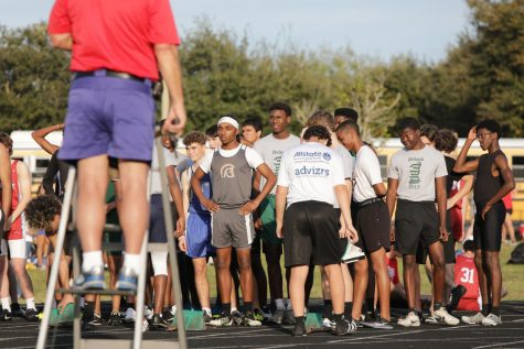 "Standing at the start line, junior Calvino Crichton prepares for his race in the 200m. Crichton got a personal record at the Deland meet. ""I motivate myself to finish strong no matter the outcome of the race,"" Crichton said. ""I had two personal records so to me, it was a successful meet."""